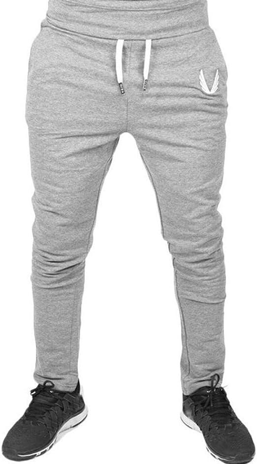 Qiusa Pantalón de chándal de algodón para Hombre Pantalones Deportivos de Gimnasia Elástica Gimnasio Entrenamiento Informal Pantalones de Gimnasio Pantalón de chándal Chándal Pantalón de Deporte Slim: Amazon.es: Hogar