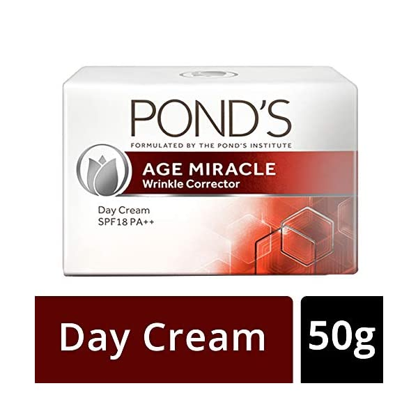 POND'S Age Miracle Wrinkle Corrector (Anti-Wrinkle) Spf 18 Pa++ Anti Aging Day Cream, 50 g 2021 July Ponds Age Miracle Wrinkle Corrector Day Cream SPF 18 PA++, with Retinol-C Complex, works 24hr non-stop to keep your skin looking youthfully radiant Uses Pond's most advanced anti-aging technology, Retinol-C Complex, to continuously release powerful anti-aging retinoid actives for 24hr non-stop, to reduce the appearance of wrinkles and boost radiance from the inside A day cream with SPF 18 PA++ to help provide daily protection against UV rays that can speed up the signs of aging. Skin Type: All Skin Types