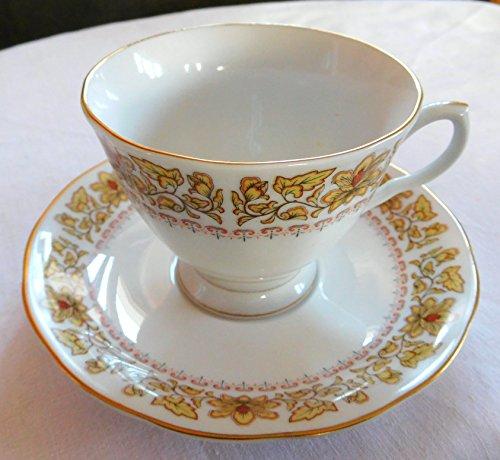 Nanjing Pagoda Tea Cup & Saucer Made in China Yellow Borders, Gold Trim