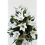 Cemetery-Spring-Flowers-Spring-white-lilly-mixheadstone-saddle-arrangementcemetery-flower-servicegrave-site-decorsympathy-flowersflowers-for-gravesLillies-and-wildflowers