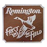Remington First In Field Embossed Metal Sign