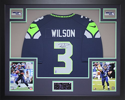 Russell Wilson Autographed Blue Seahawks Jersey - Beautifully Matted and Framed - Hand Signed By Russell Wilson and Certified Authentic by Auto Wilson COA - Includes Certificate of Authenticity