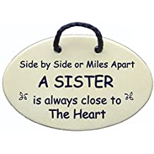 Sister, love, sister friends, wall plaque. Side by side or miles apart a sister is always close to the heart. Made in the USA.