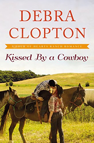 Kissed by a Cowboy (A Four of Hearts Ranch Romance) by [Clopton, Debra]