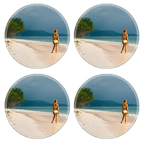 luxlady-round-coasters-young-woman-standing-at-the-beach-looking-far-into-the-ocean-image-22629756-c
