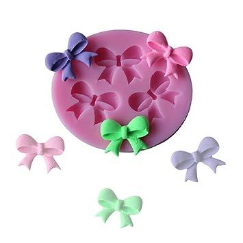 Lindo molde de silicona con forma de lazos para decoracion de ponquecitos: Amazon.es: Hogar