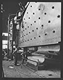 1942 Photo Production. Steam power plant equipment. A section plate for a new high-pressure boiler is formed on a 6,000-ton hydraulic press. Steam boilers and other power-house equipment to supplement