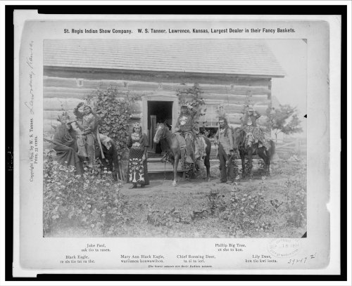[Historic Print (L): [Group portrait of St. Regis Mohawk men and women in costume outside log building,] (Log Costume)