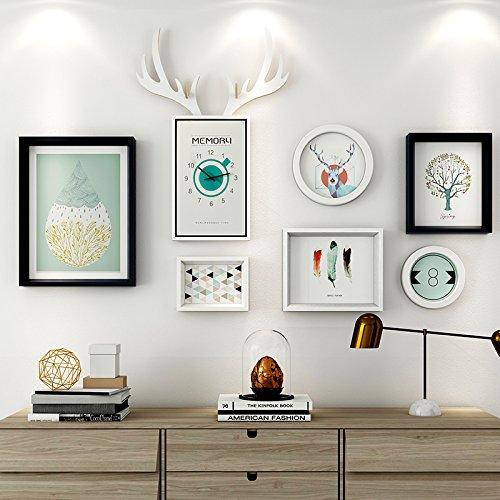 Das Wohnzimmer dekorativen Wandmalereien im Restaurant ist eine Kombination aus 6 Box + Hirschkopf Uhren schwarz-Weiß-Mash-ups