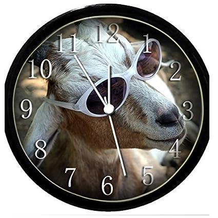Brilla en la oscuridad reloj de pared - cabra con gafas de ...