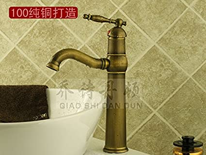 Antique copper fire hoses and single cold water faucet, brass basin ...