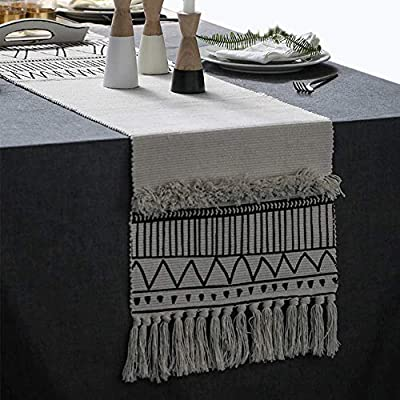 Moroccan Fringe Table Runner 14 X 72 in, KIMODE Bohemian Geometric Cotton Fabric Handmade Woven Tufted Tassels Farmhouse Table Linen Machine Washable Minimalist Home Decorative, Black and White - FITS TABLES FOR 4 to 6 PEOPLE: 14 in x 72 in ( Length 72 inch not include tassel ); macrame runner with extra in long handmade woven snazzy tassels on each side,gives a chic feeling and creates a relaxed mood in your room. CLASSY MATERIAL AND UNIQUE DESIGN: Fringe table runner use exquisite cutting with premium quality cotton and hemp fabric,add fringe and tufted vibe on this table runner,black and white colored lines looks more romantic and minimalist. MULTIFUNCTIONAL UTILIZATION: Suitable for most rectangular table, round table, and square table, and it not only moroccan decor dining table but also tea table, shoe cabinet, and TV stand, etc;great gift at housewarmings, holidays and birthdays. - table-runners, kitchen-dining-room-table-linens, kitchen-dining-room - 51NIepopMTL. SS400  -
