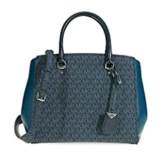 A Michael Kors tote crafted in signature logo print with a fully lined interior and silver-tone hardware. This Michael Kors bag features 1 main compartment, 1 exterior slip pocket, wall slip pockets, 2 zip pockets, 2 leather handles, zip top ...