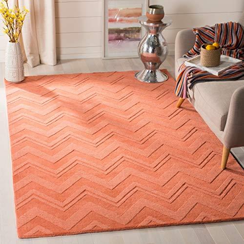 - Safavieh Impressions Collection IM398A Handmade Peach Premium Wool Area Rug (5' x 8')
