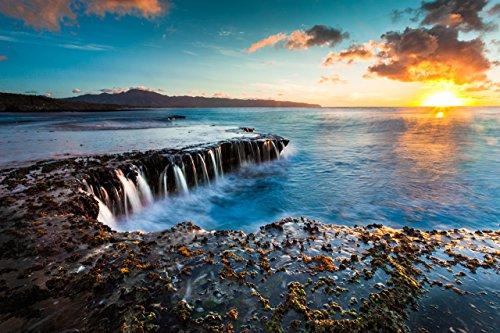 water-cascading-off-of-a-rocky-shelf-under-a-golden-sunset-at-sharks-cove-north-shore-oahu-hawaii-pr