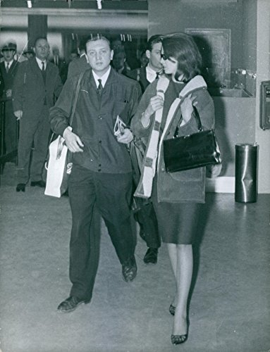 1963 Vintage Port (Vintage photo of Christine Margaret Keeler walking with a man at airport, 1963.)