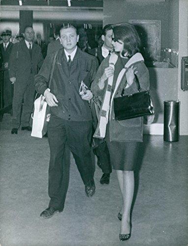 1963 Vintage Port (Vintage photo of Christine Margaret Keeler walking with a man at airport, 1963.)