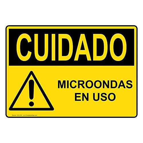 OSHA Caution Microondas En USO Sign with Spanish Text and ...