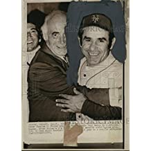 1973 Wire Photo Oakland- Oakland A's owner Charles O Finley embraces Yogi Berra