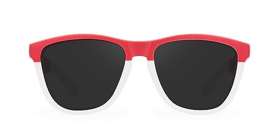 1e36b042bd HAWKERS · SPAGO · Frozen white · Black · Gafas de sol para hombre y mujer:  Amazon.es: Ropa y accesorios