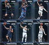 2018-19 Panini Prizm Basketball New York Knicks Team Set of 11 Cards with rookies: Patrick Ewing(#105), Allonzo Trier(#209), Kevin Knox ROOKIE (#217), Mitchell Robinson(#227), Tim Hardaway Jr.(#237), Frank Ntilikina(#247), Mario Hezonja(#257), Kristaps Porzingis(#267), Enes Kanter(#277), Trey Burke(#287), Courtney Lee(#297)