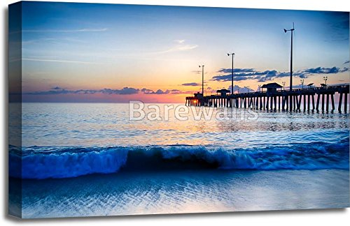 The Rising Sun Peeks Through Clouds And Is Reflected In Waves By The Nags Head Fishing Pier On The Outer Banks Of North Carolina Paper Print Wall Art Gallery Wrapped - In Nags Head