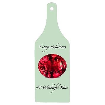 """Tabla para picar en forma de botella de vidrio con la inscripción """""""