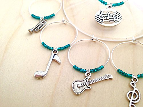 Musical theme Wine Charms, Music Teacher Gift, Musical Instruments include trumpet, guitar, and violin. winecharm Set of 4 to Set of 7. ()
