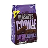 Chocolate cookie pieces and chocolate creme, all wrapped in classic HERSHEY'S Chocolate. That's HERSHEY'S COOKIE LAYER CRUNCH Bar-in a triple chocolate combination. Unwrap a bar, break off a square and reimagine happy.with a twist.