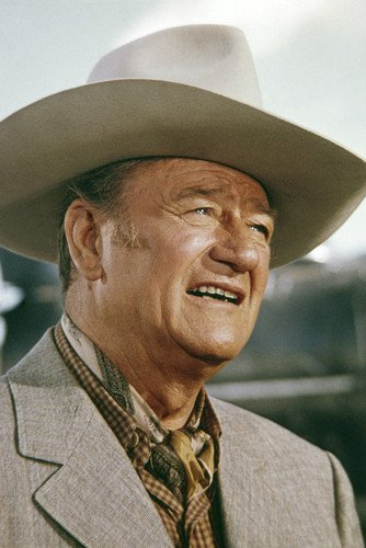 f62f8b1be John Wayne in Big Jake smiling in smart suit and stetson by train ...