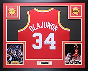 Hakeem Olajuwon Autographed Red Rockets Jersey - Beautifully Matted and Framed - Hand Signed By Hakeem Olajuwon and Certified Authentic by Auto JSA COA - Includes Certificate of Authenticity