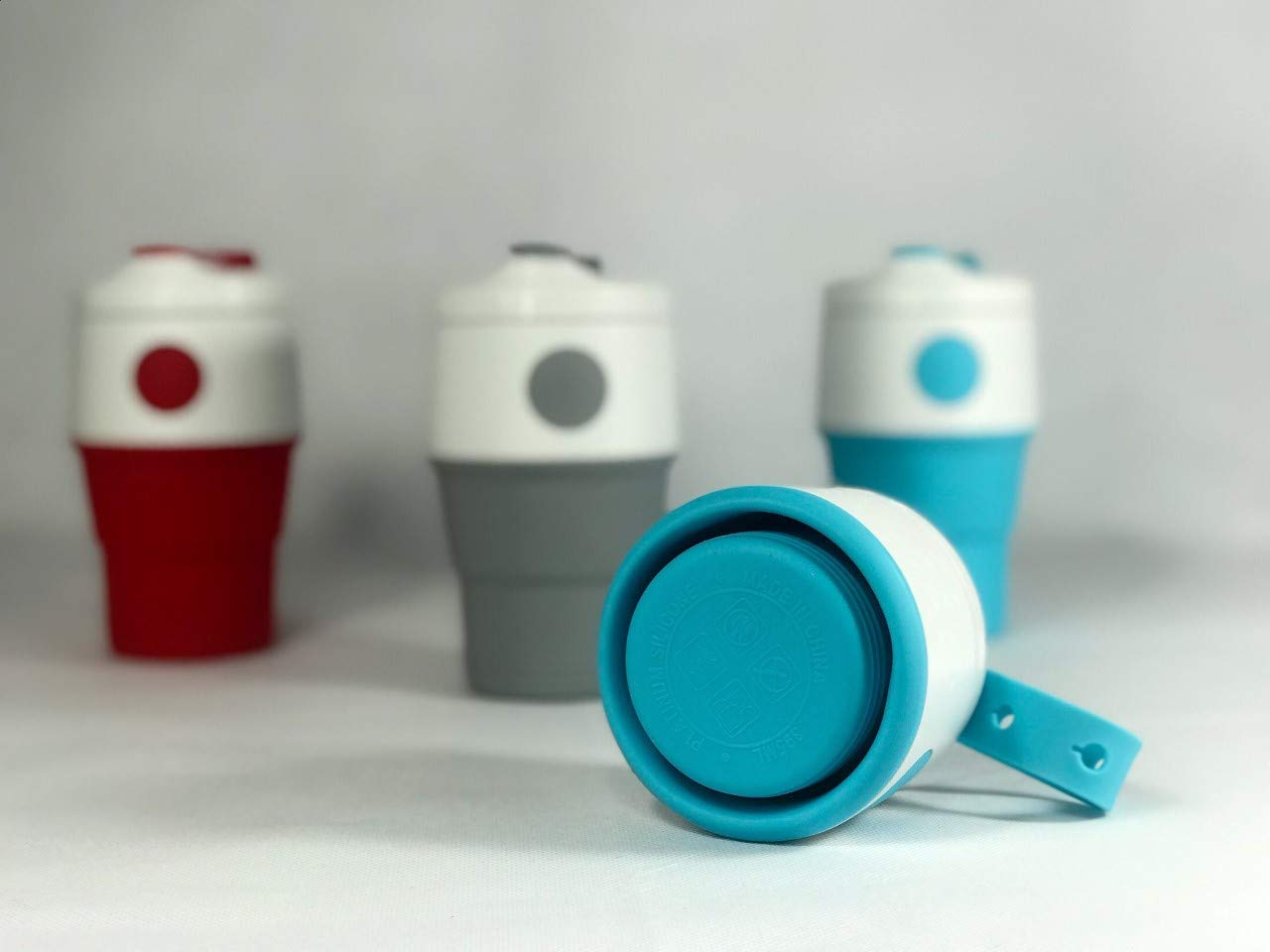Hot or Cold Compact and Tight Seal Environmentally friendly by Reducing Paper Cup Use Four Stones Gray   Great for Travel and Sports Silicone Coffee Cup