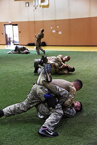 members-of-the-341st-security-forces-group-at-malmstrom-air-force-base-spar-during-a-combatives-inst