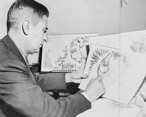 1957 photo Dr. Seuss (Ted Geisel) at work on a drawing of a grinch, the hero of his forthcoming book,