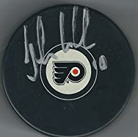 Autographed John Leclair Philadelphia Flyers Hockey Puck