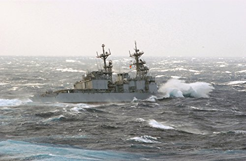 LAMINATED POSTER At sea with USS Paul F. Foster (DD 964) Oct. 29, 2002The destroyer USS Paul F. Foster turns away