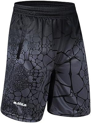 Los hombres en el deporte del baloncesto elásticos nuevos cortos ...