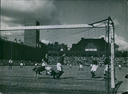 vintage-photo-of-footballers-playing-football-in-the-ground-during-a-matchfootball-stadium-holsten19