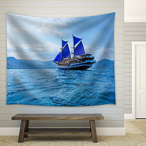 Sailing Boat with Blue Sail on The Sea