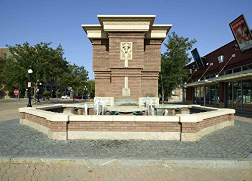 Photograph  Roth Fountain, which was dedicated in 2005, mirrors in its tripartite facade the historical 1915 Livestock Exchange Building formerly located in the Sioux City Stockyards 44in x 30in