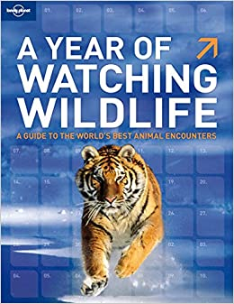 A year of watching wildlife general reference guide lonely a year of watching wildlife general reference guide lonely planet 9781741792799 amazon books fandeluxe Images