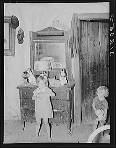 Missouri Photo Workshop - 1938 Photo Southeast Missouri Farms. Children of FSA (Farm Security Administration) client, former sharecropper, in bedroom of shack home. Note sign