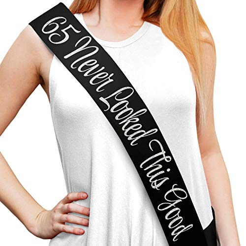 """65 Never Looked This Good"" Black Glitter Satin Sash - Happy 65th Birthday Party Supplies, Ideas and Decorations - Funny Birthday"