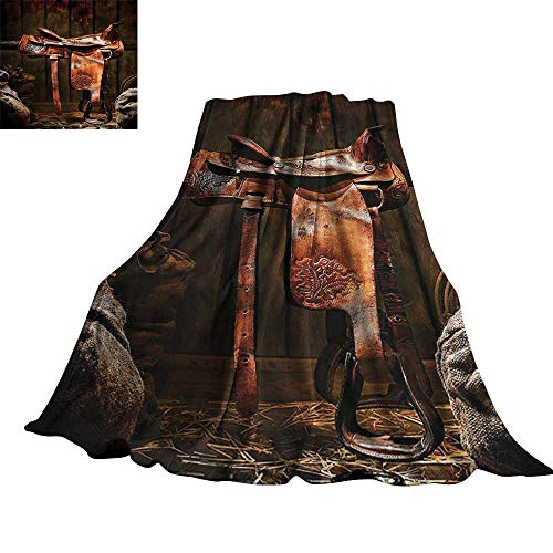 Western Decor Collection Warm Blanket Rodeo Cowboy Leather Western Saddle on Wood Beam in Rustic Ranch Wood Barn Picture 36
