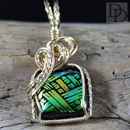 Coordinate this Dichroic Glass pendant with any ensemble from business casual to everyday wear.