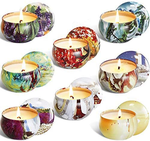 This is an image of scented candles in a can, in various colors.