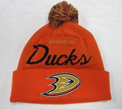 a8a05432102 Amazon.com  Anaheim Ducks Script Cuffed Pom Knit Beanie Hat Cap ...