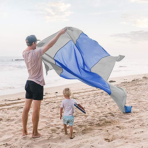 WildHorn Outfitters Sand Escape Beach Blanket. Compact Outdoor Beach Mat Made from Strong Parachute Nylon. Large 7' x 9' Size. Includes Built in Sand Anchors & Zippered Valuables Pocket.