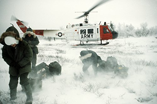 Air Force personnel begin a search and rescue exercise after arriving in a wilderness area via an Ar