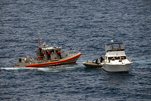 Coast Guard Station (A 45-foot Response Boat from U.S. Coast Guard Station San Diego stands by as Sailors aboard a rigid)